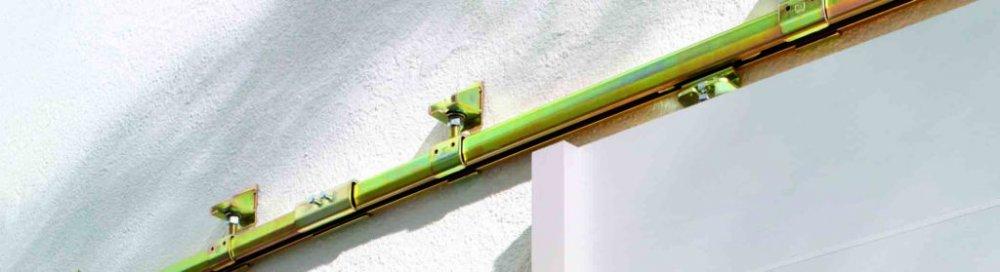 Alfa a omega posuvného systému dveří či vrat